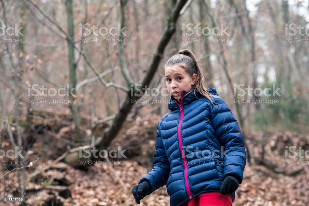 Cute girl walking in the woods stock photo