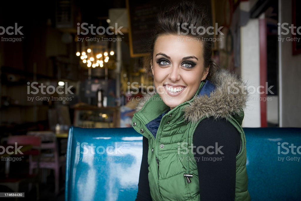 Beautiful Brunette Young Woman Portrait in Restaurant Booth, Copy Space royalty-free stock photo