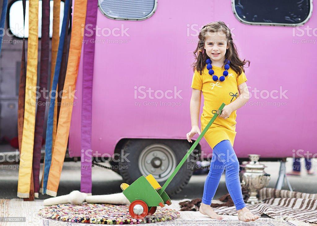 cute girl wearing yellow dress playing outdoors royalty-free stock photo
