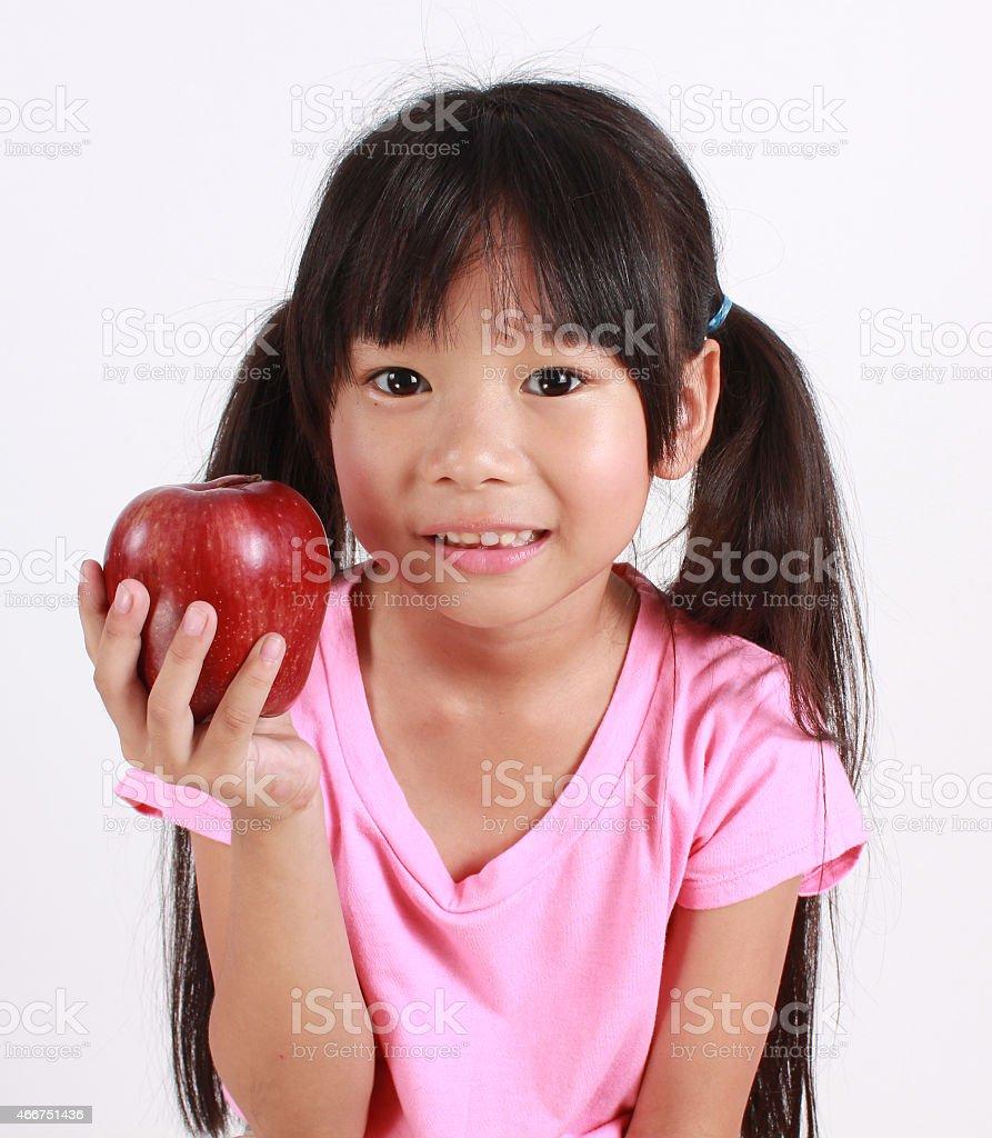 Süßes Mädchen mit apple Lizenzfreies stock-foto