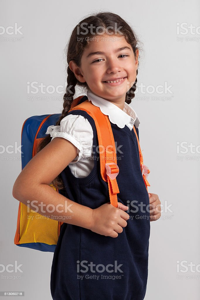 Cute girl with back pack stock photo
