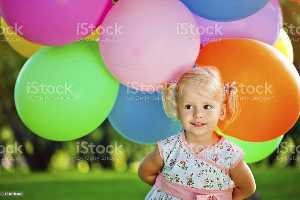 Cute girl with balloons royalty-free stock photo