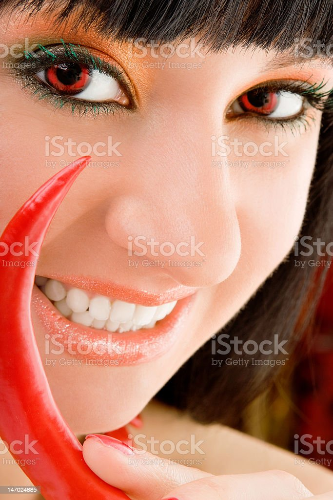 cute girl with chili pepper stock photo