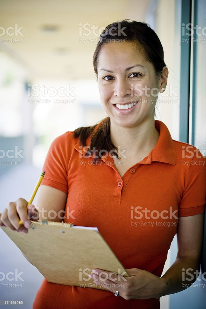 cute girl with clipboard and pencil royalty-free stock photo
