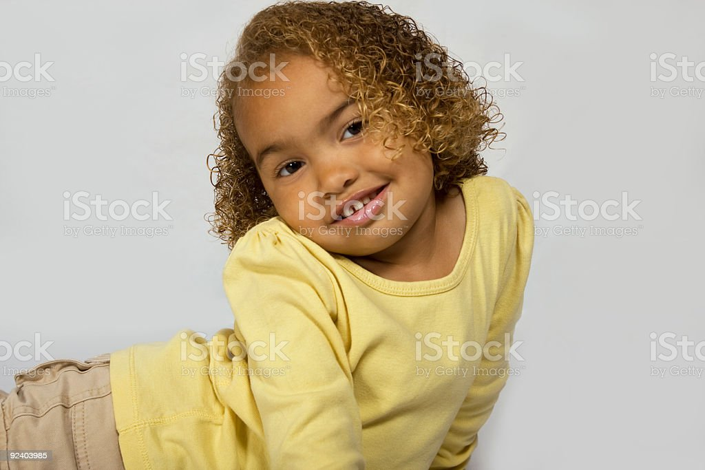 Cute girl with curly hair stock photo