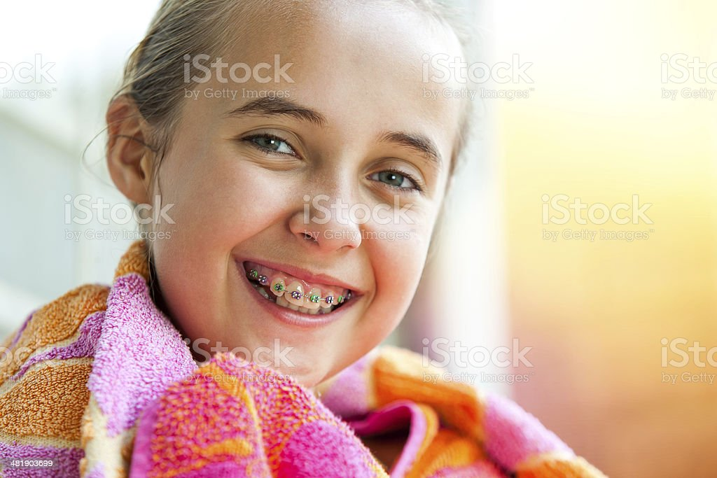 Cute girl with dental braces. stock photo