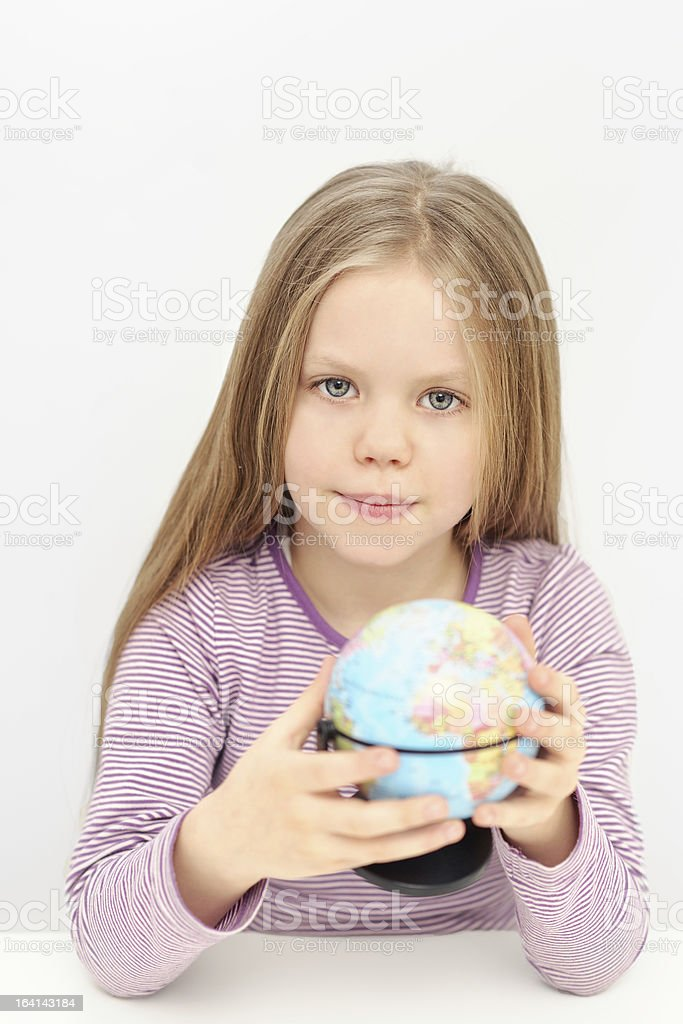 Cute girl with globe is dreaming about travels royalty-free stock photo