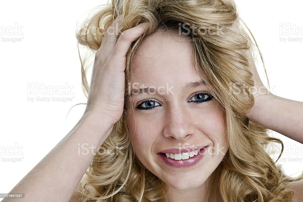 Cute girl with hands in her hair royalty-free stock photo