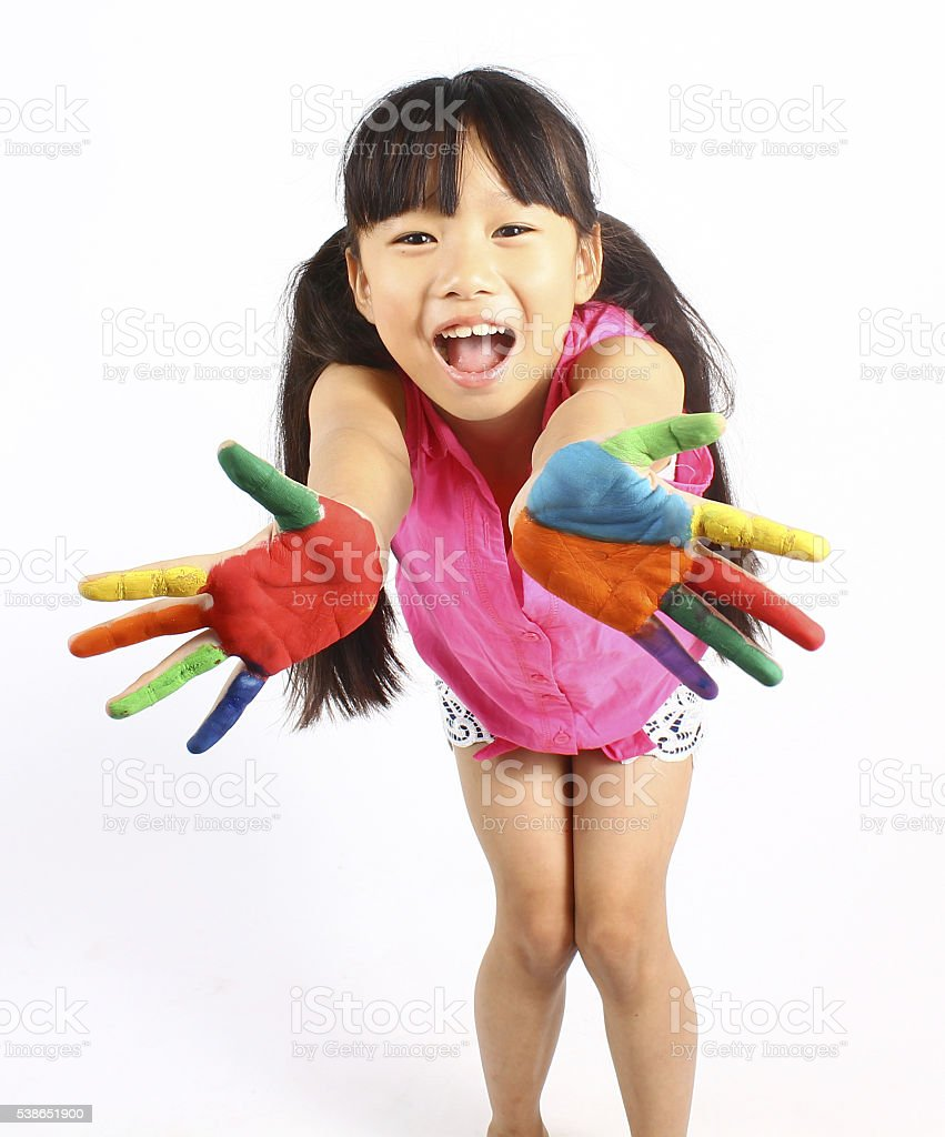 Cute girl with hands in the paint stock photo