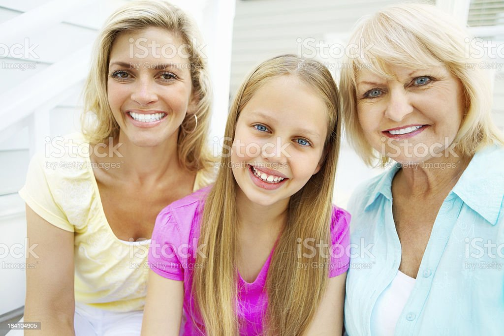 Cute girl with her mother and grandmother smiling royalty-free stock photo