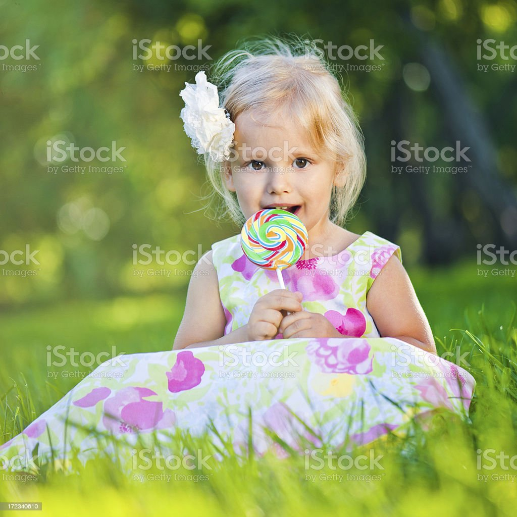 Cute girl with lollipop royalty-free stock photo