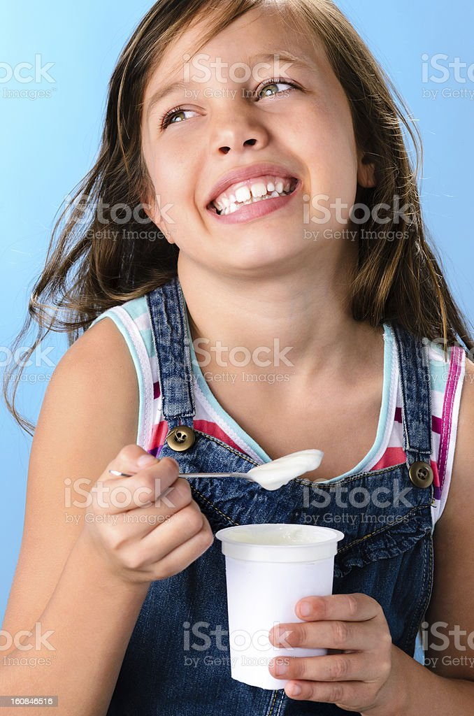 Cute girl with probiotic rich yoghurt royalty-free stock photo