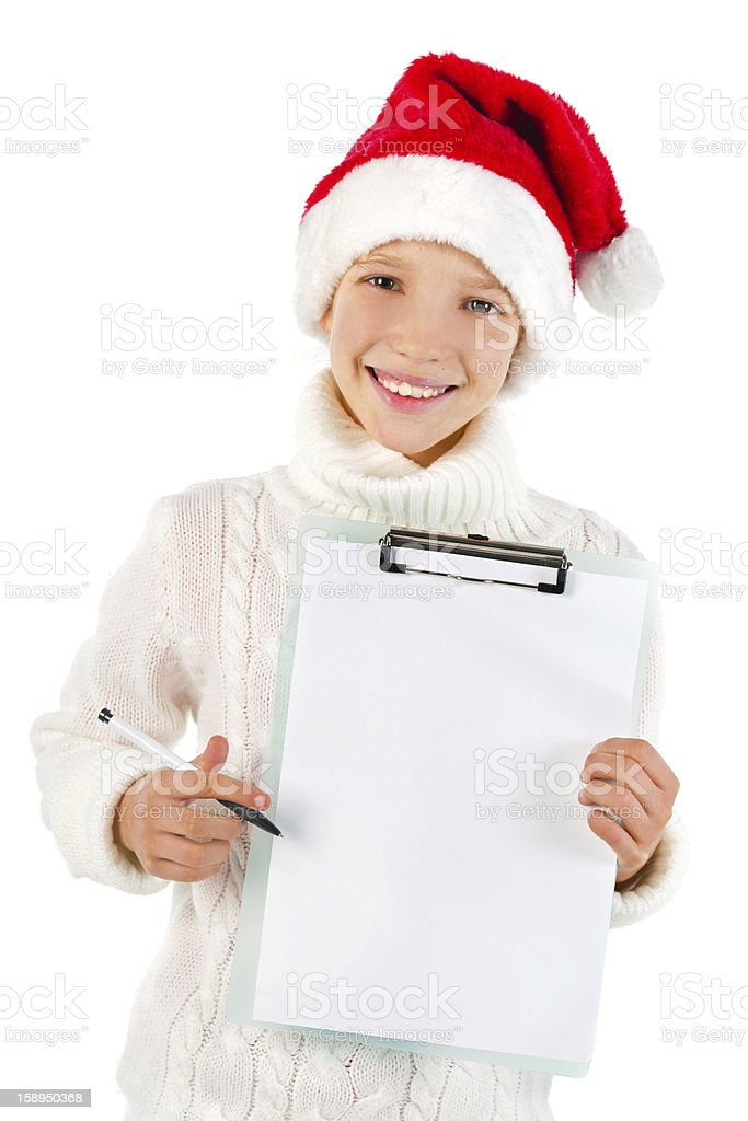 Cute girl with Santa hat showing a blank paper royalty-free stock photo