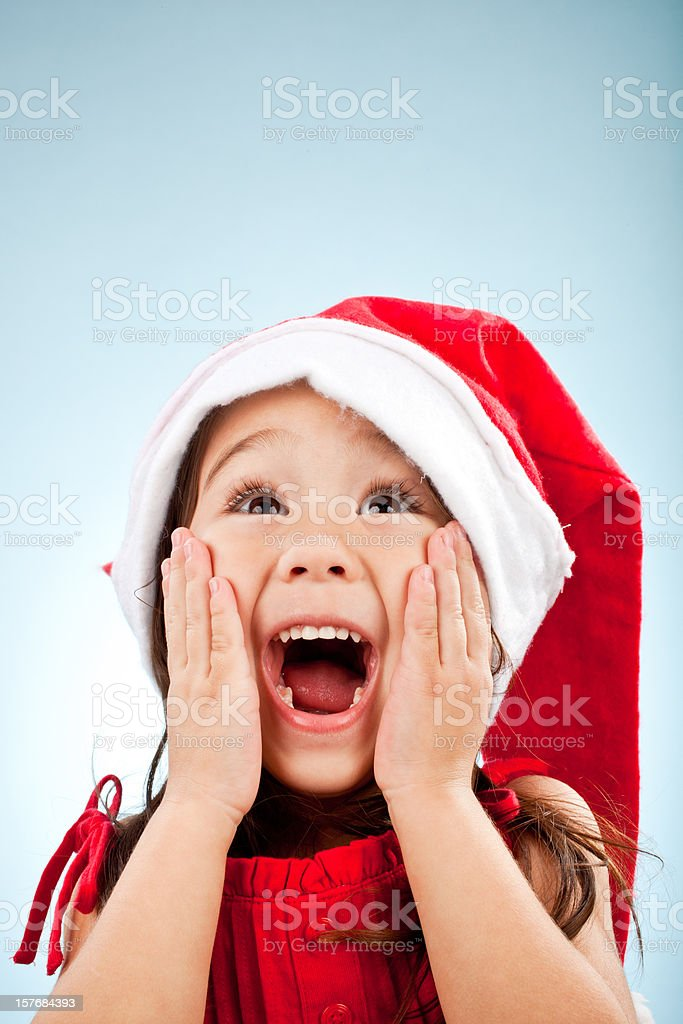 cute girl with santa hat surprise royalty-free stock photo