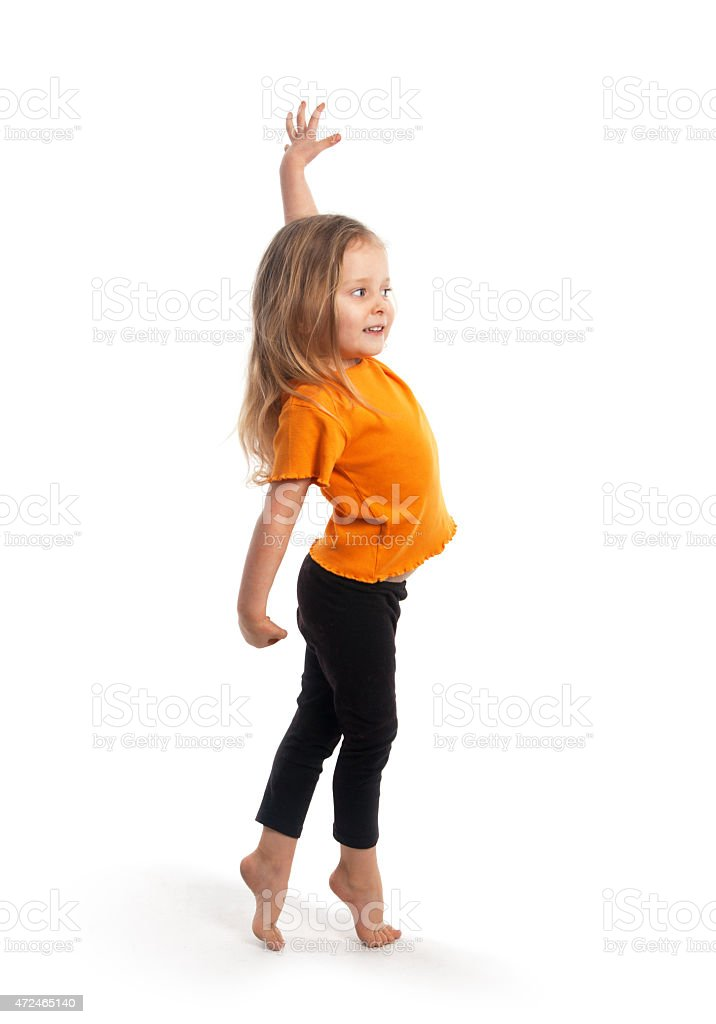 Cute girl with t-shirt and leggings imitating a ballerina stock photo