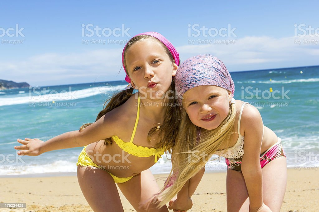 Cute girlfriends on beach. royalty-free stock photo