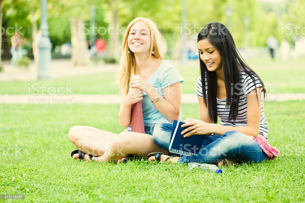Cute girls reading a book royalty-free stock photo