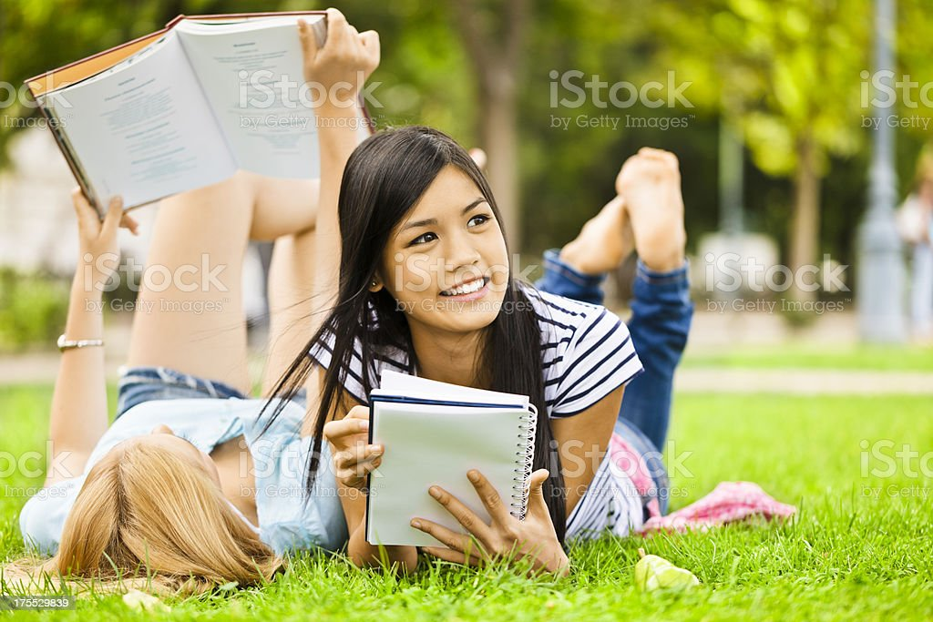 Cute girls reading books royalty-free stock photo