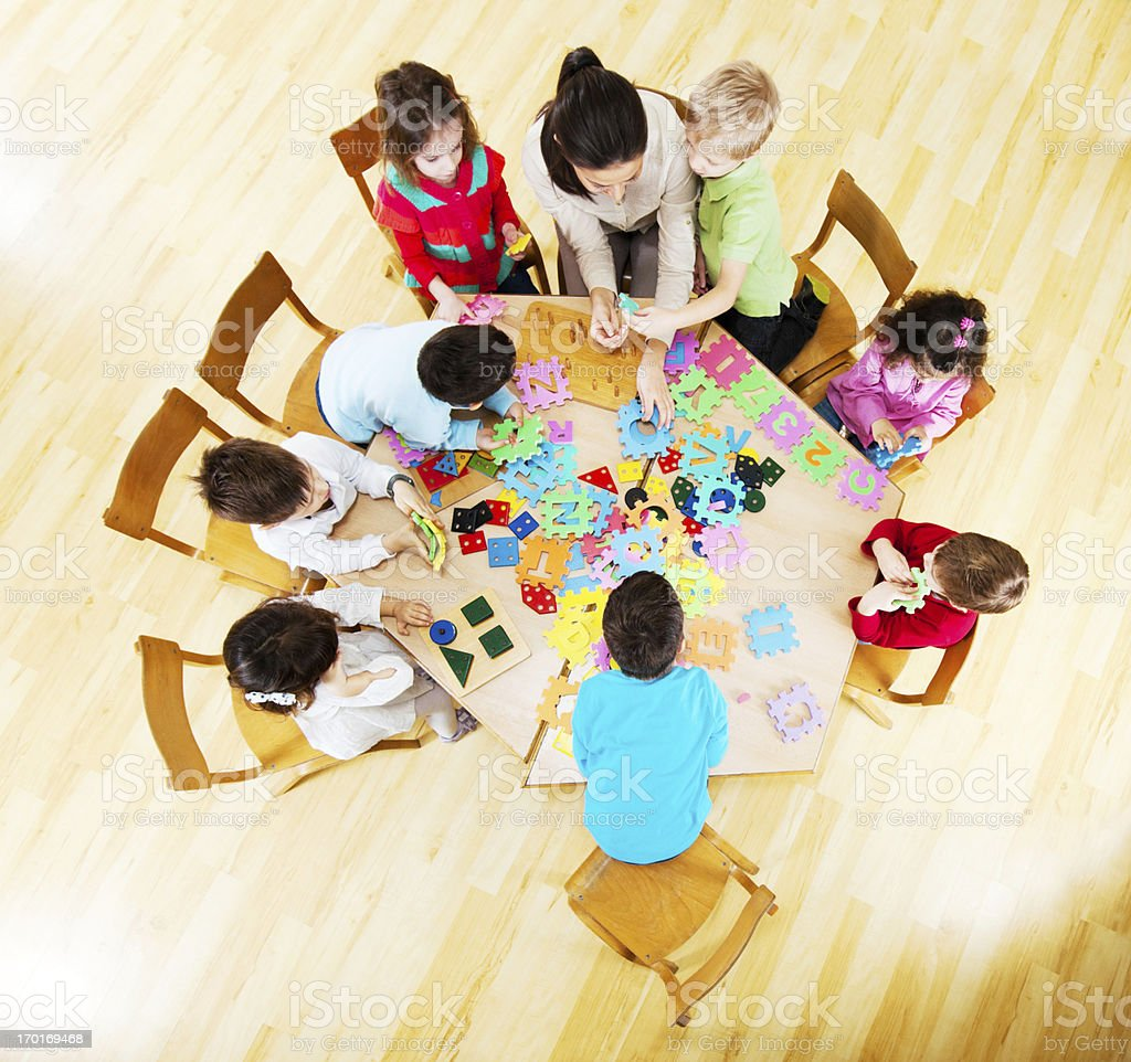 Cute group of children with a nursery teacher. royalty-free stock photo