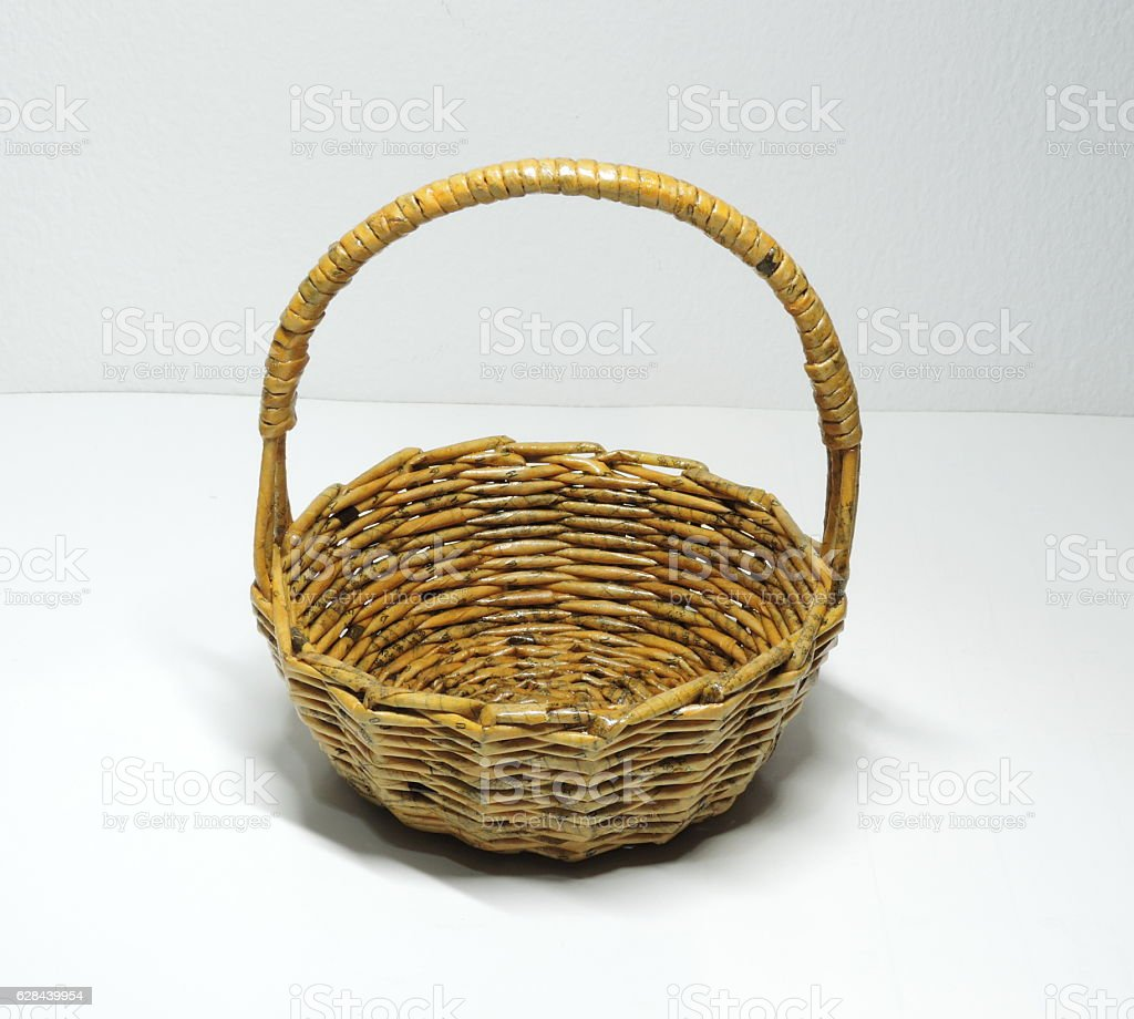 Cute handmade basket made of newspapers paper. stock photo