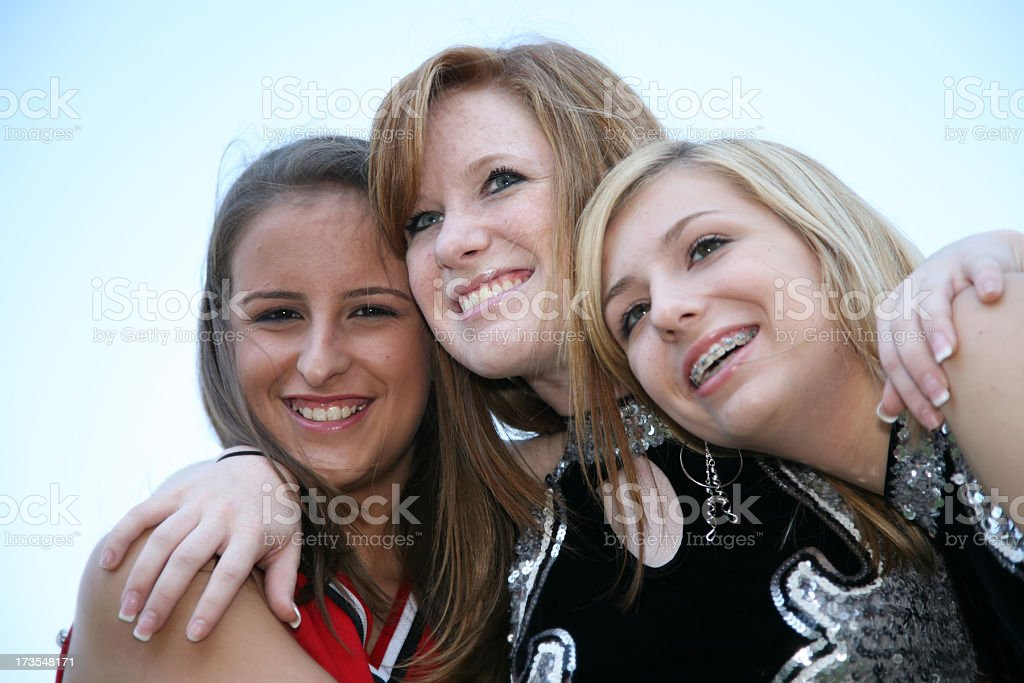 Cute Happy Cheerleader Friends Hanging Out Together royalty-free stock photo