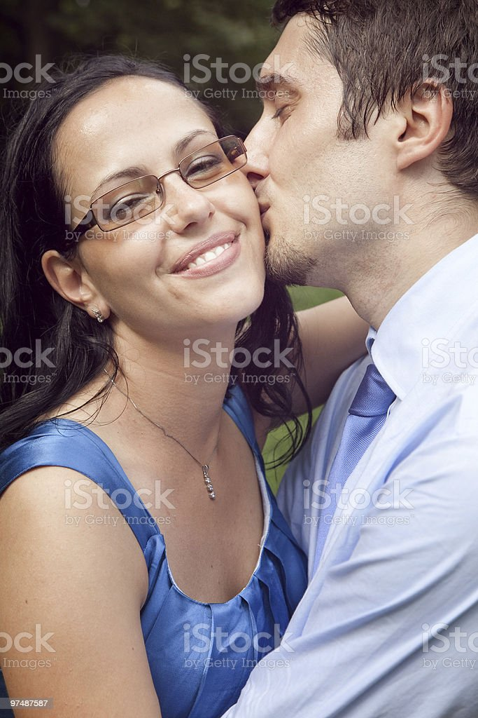 Cute happy couple in a kiss intimate moment stock photo