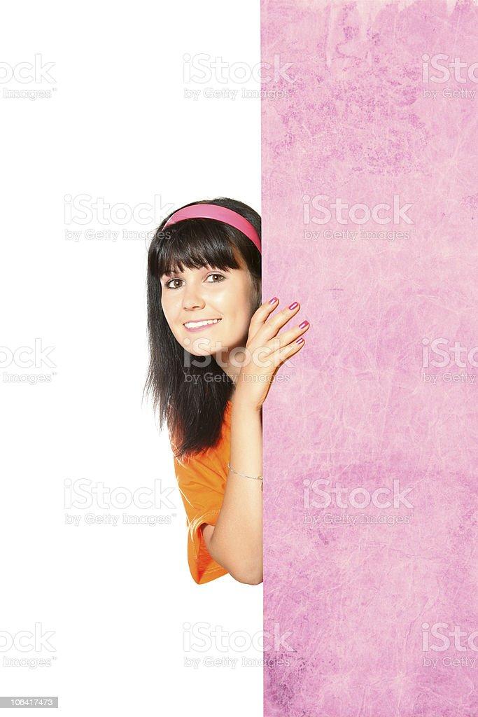 Cute happy girl looking around a corne stock photo