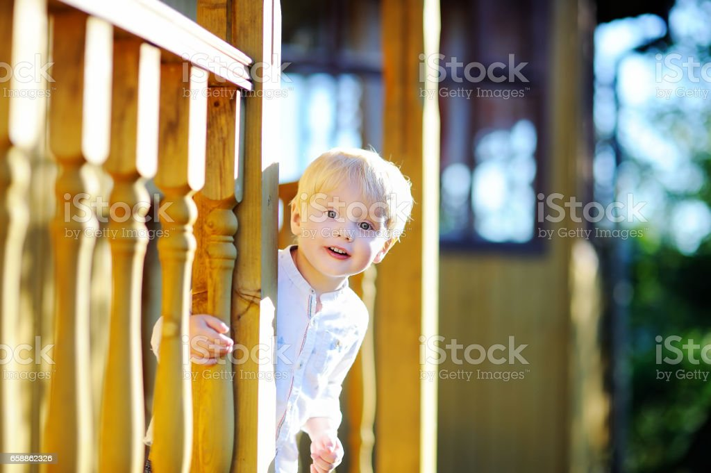 Cute happy little boy having fun outdoors on sunny summer day stock photo