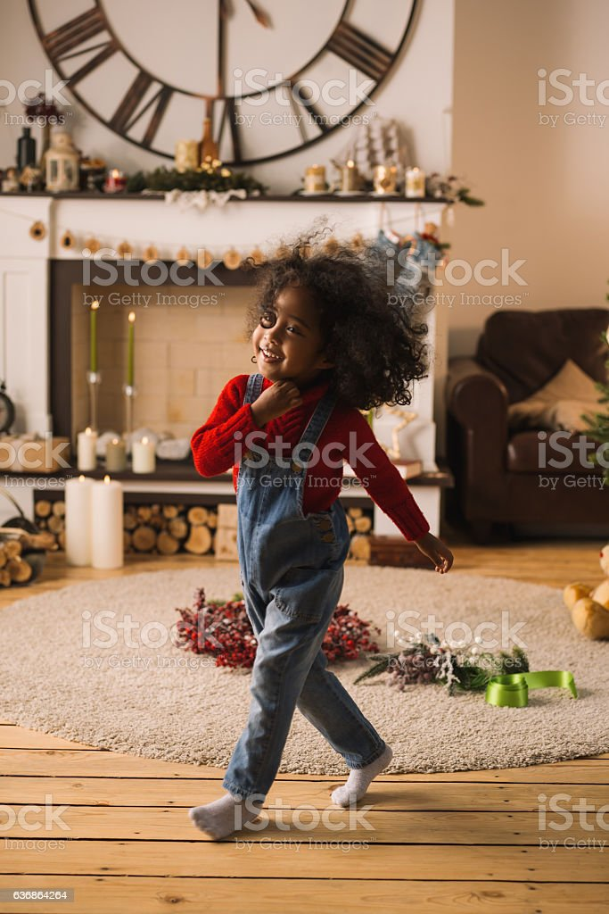 Cute happy little Girl at Home with Christmas Interior stock photo