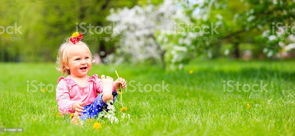 cute happy little girl enjoy spring nature, panorama stock photo