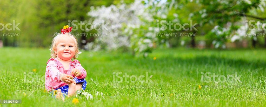 cute happy little girl enjoy spring nature stock photo