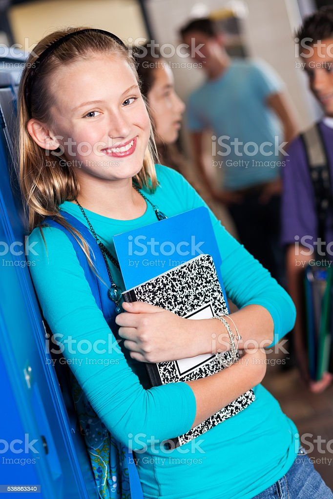Cute high school freshman in school hallway stock photo