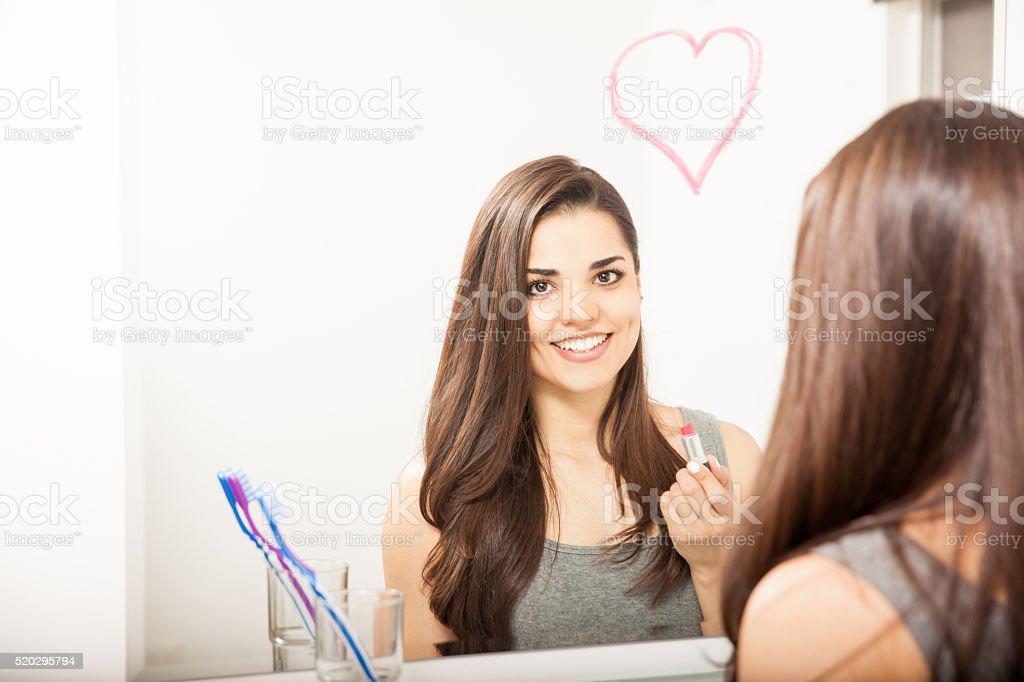 Cute Hispanic woman drawing a heart stock photo