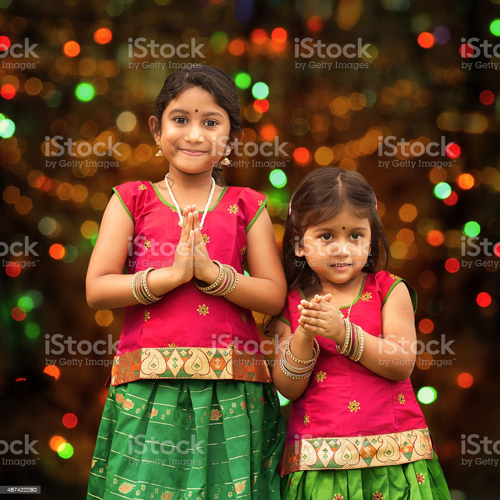 Cute Indian girls greeting stock photo