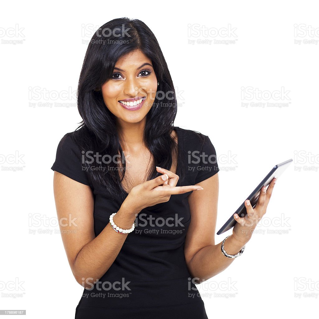 cute indian woman pointing tablet computer royalty-free stock photo