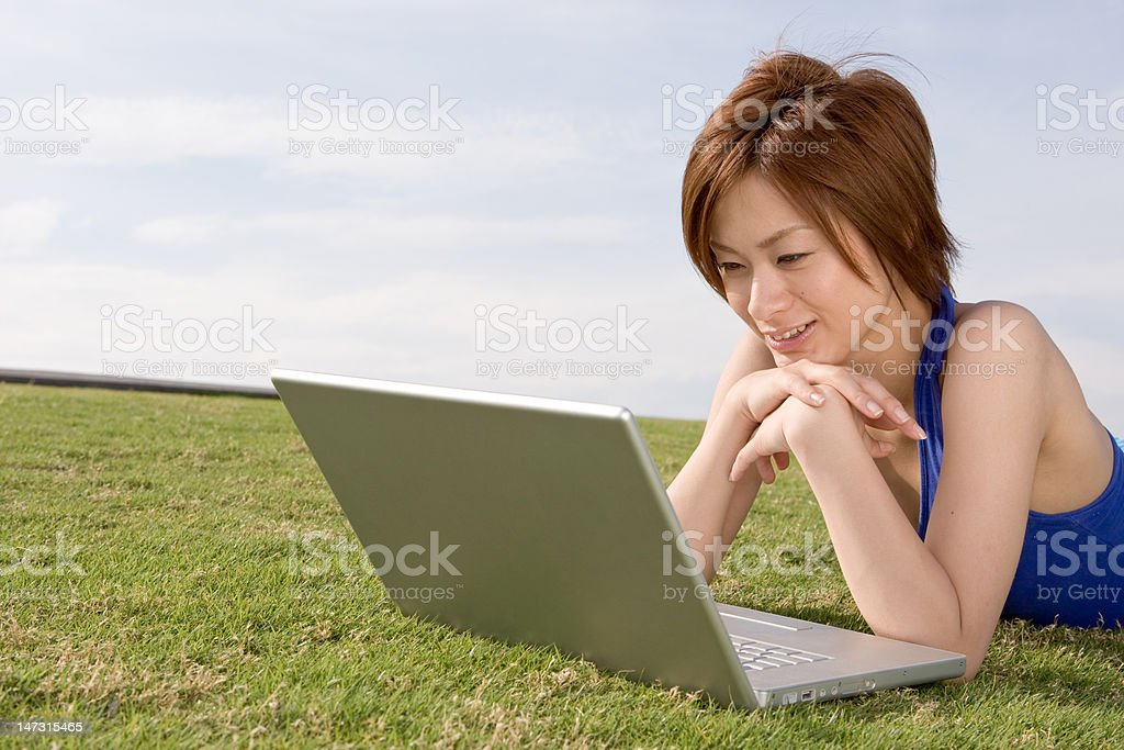 Cute Japanese girl reading a laptop royalty-free stock photo