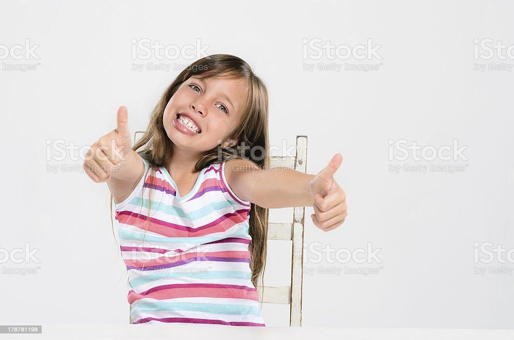 Cute kid at a table royalty-free stock photo
