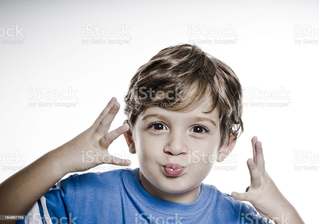 cute kid funny face with hands stock photo