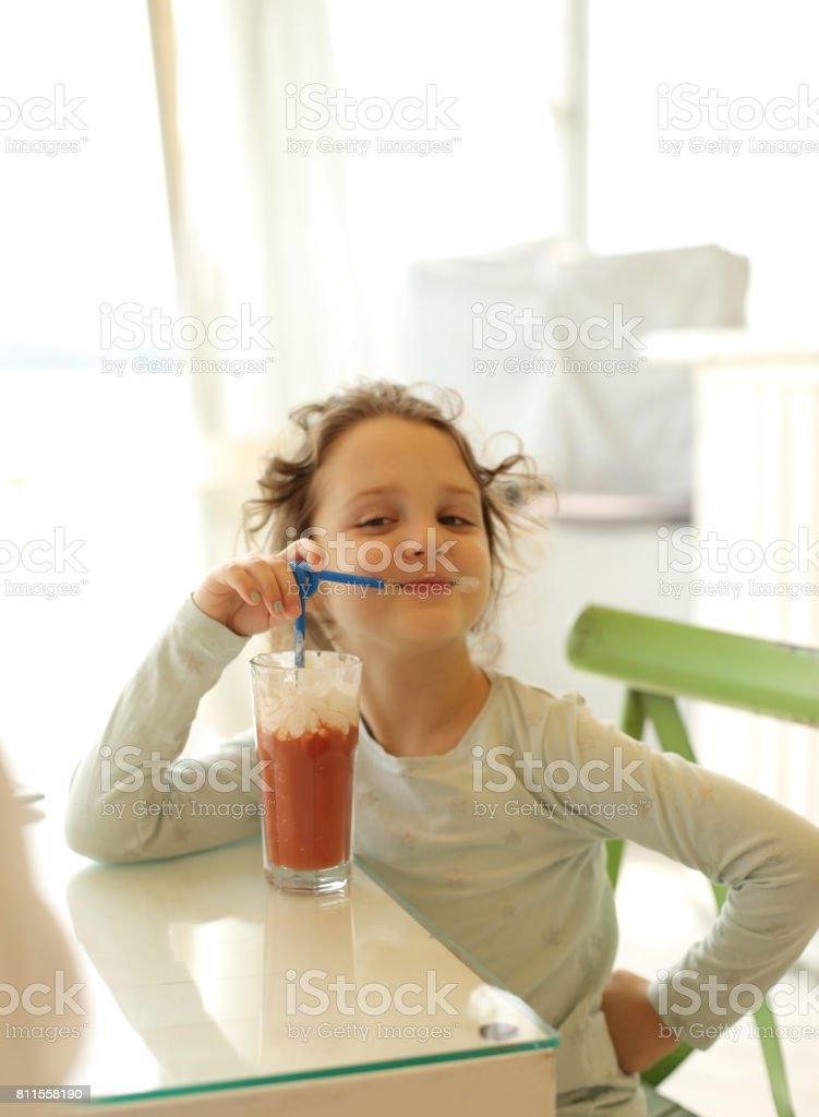 Cute kid girl posing in sun light stock photo