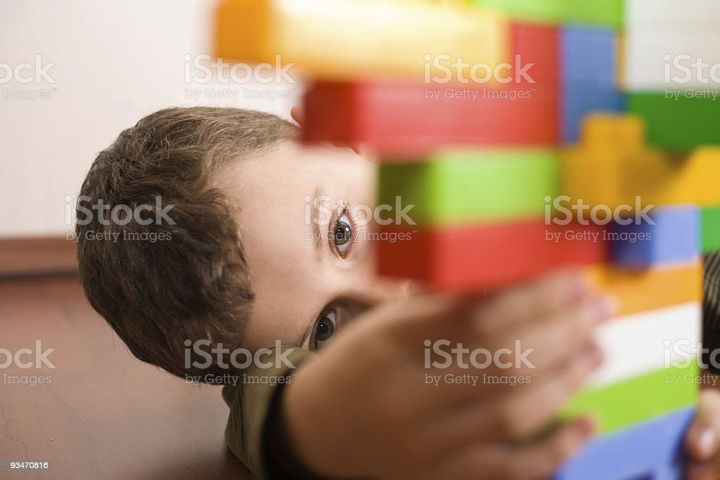 Cute kid playing with cubes stock photo