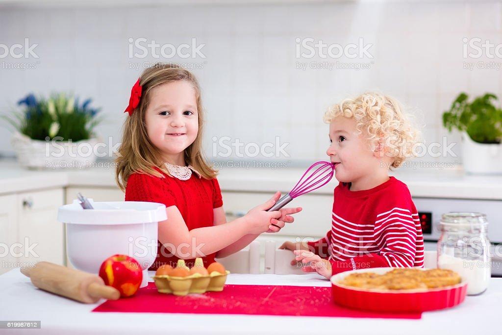 Cute kids baking apple pie stock photo