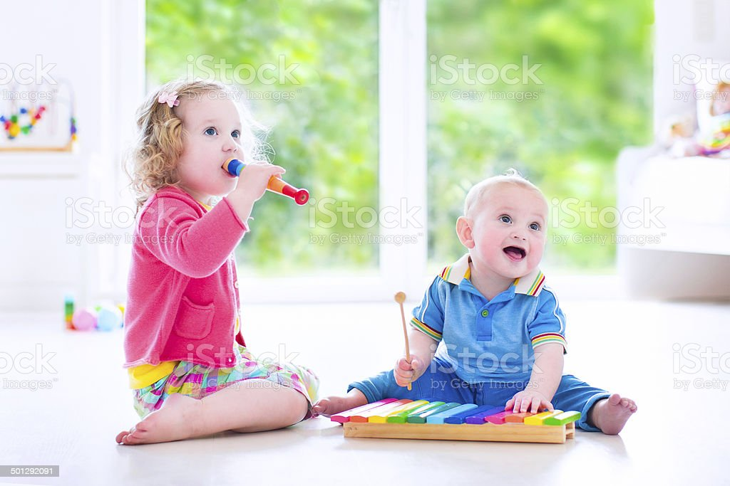 Cute kids playing music with xylophone stock photo