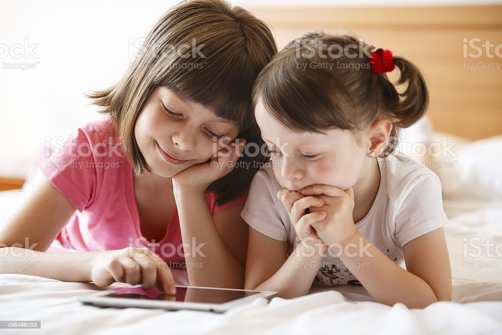 Cute kids with digital tablet royalty-free stock photo