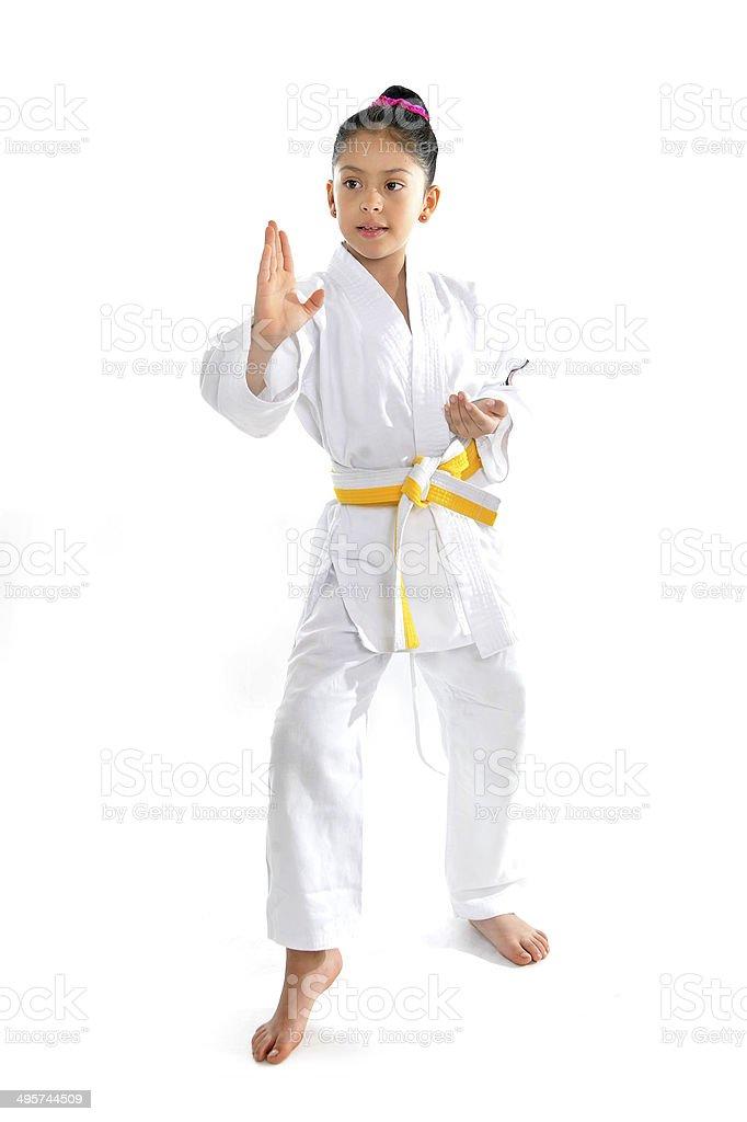 cute latin little girl in karate kimono training position stock photo