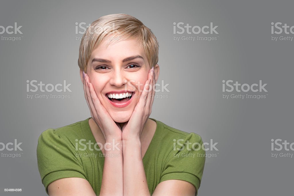 Cute laughing shocked surprised perfect smile white teeth happy dental stock photo
