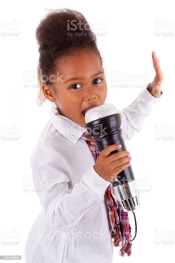Cute little African Asian girl  singing stock photo