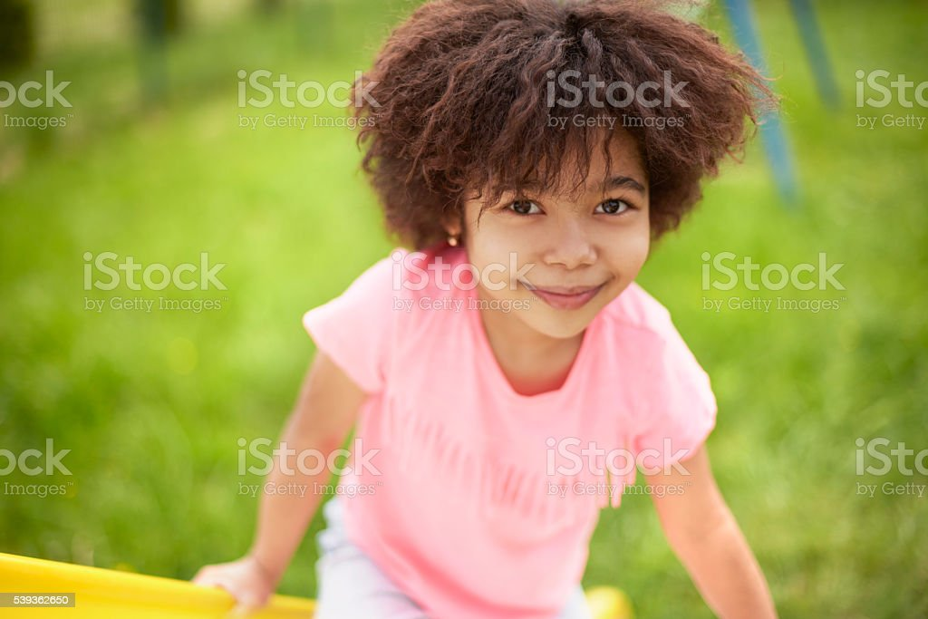 Cute little african girl at the playground stock photo