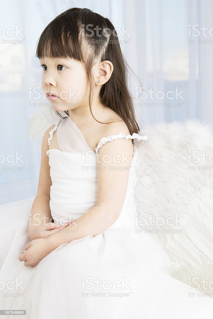 Cute little asian girl angel royalty-free stock photo