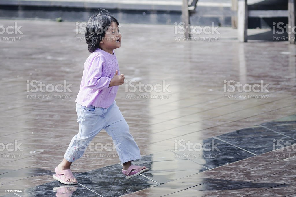 cute little asian girl playing in the park royalty-free stock photo