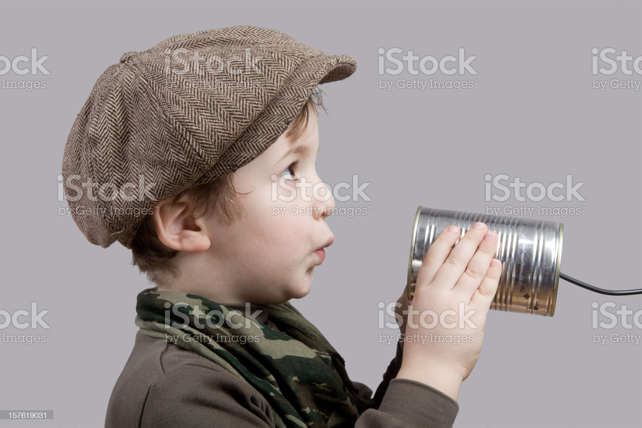 Cute Little Boy Communicating On Tin Can Phone royalty-free stock photo